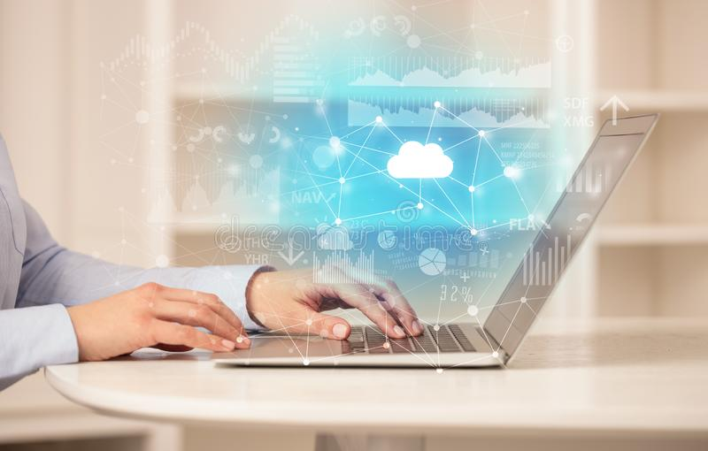 Business woman working on laptop with cloud technology concept royalty free stock photo
