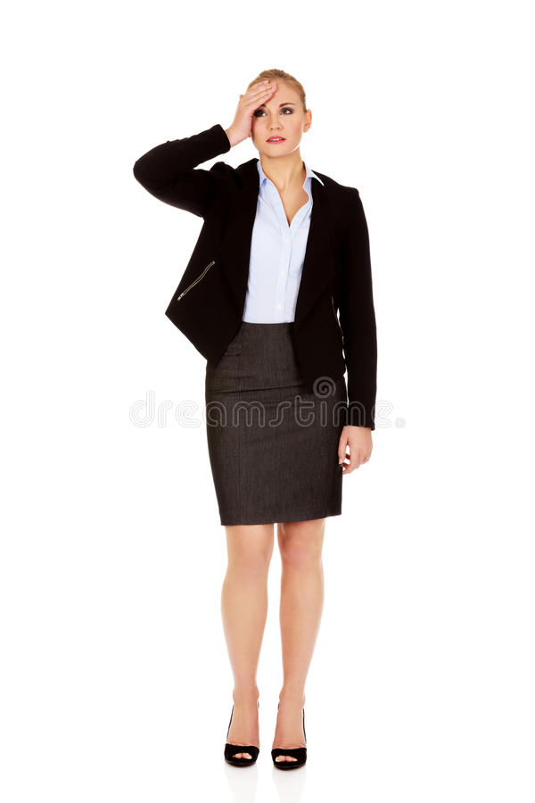 Business woman with a huge headache holding head royalty free stock image