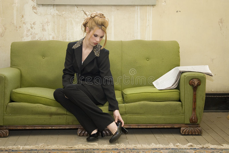 Business Woman in Impoverished Home royalty free stock photography