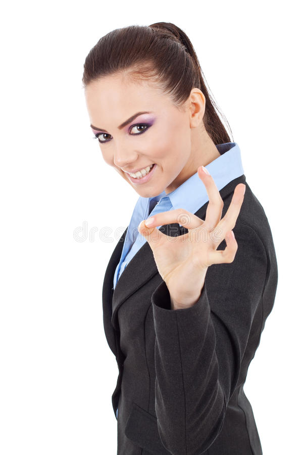 Business woman indicating ok sign royalty free stock photography