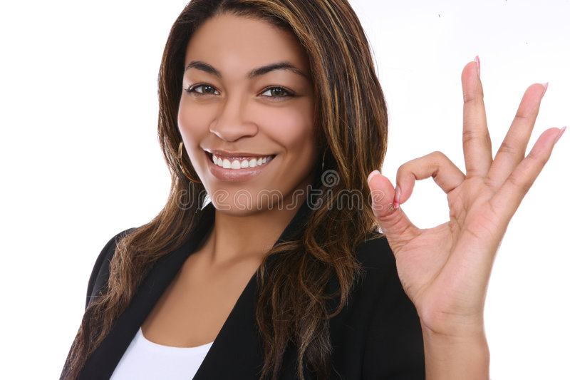 Business Woman Indicating Success. A pretty african american business woman indicating success stock image