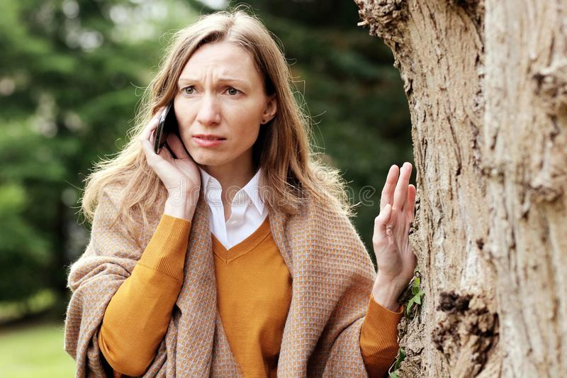 Worried business woman talking on the mobile phone stock images