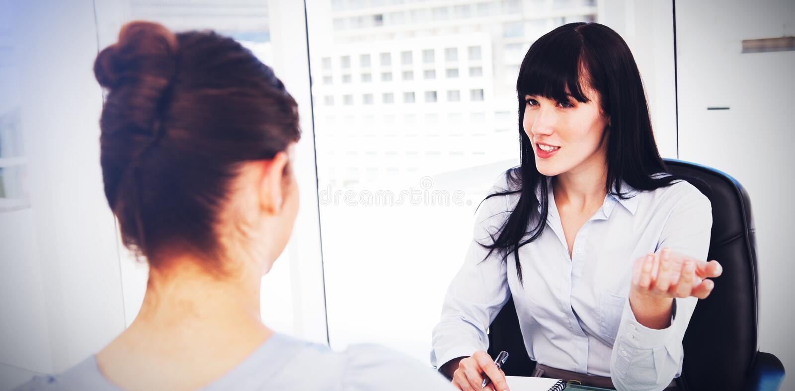 Business woman interviews a potential new employee stock photography