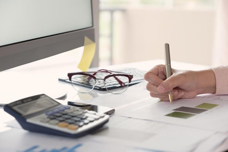 Business woman investment consultant analyzing company annual financial report balance sheet statement working with documents royalty free stock photos