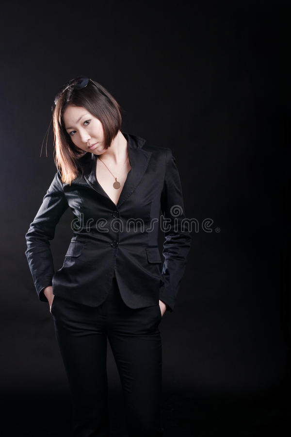 Business-woman isolated on black stock photography