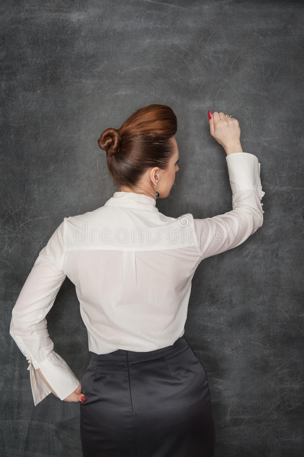 Business woman knock. Beautiful stylish business woman in the white blouse knock by her fist royalty free stock photos