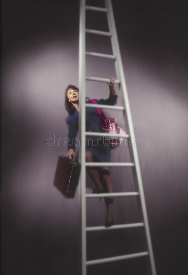 Business woman on ladder with diaper bag. Business woman on ladder holding diaper bag stock photo