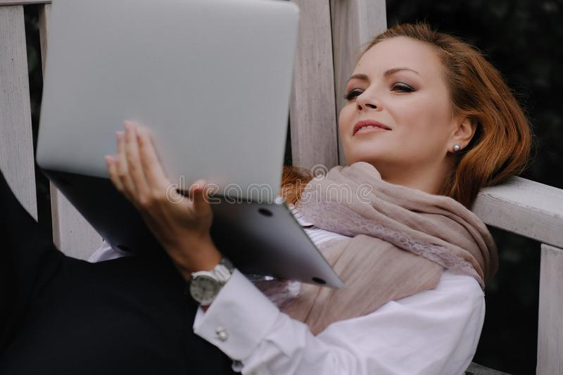 Business woman with laptop royalty free stock photography