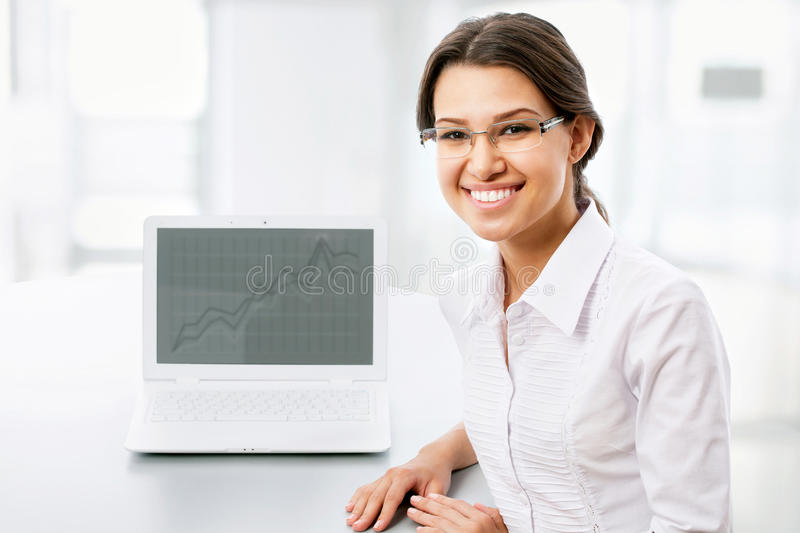 Business woman with laptop. Business woman showing blank laptop stock photography
