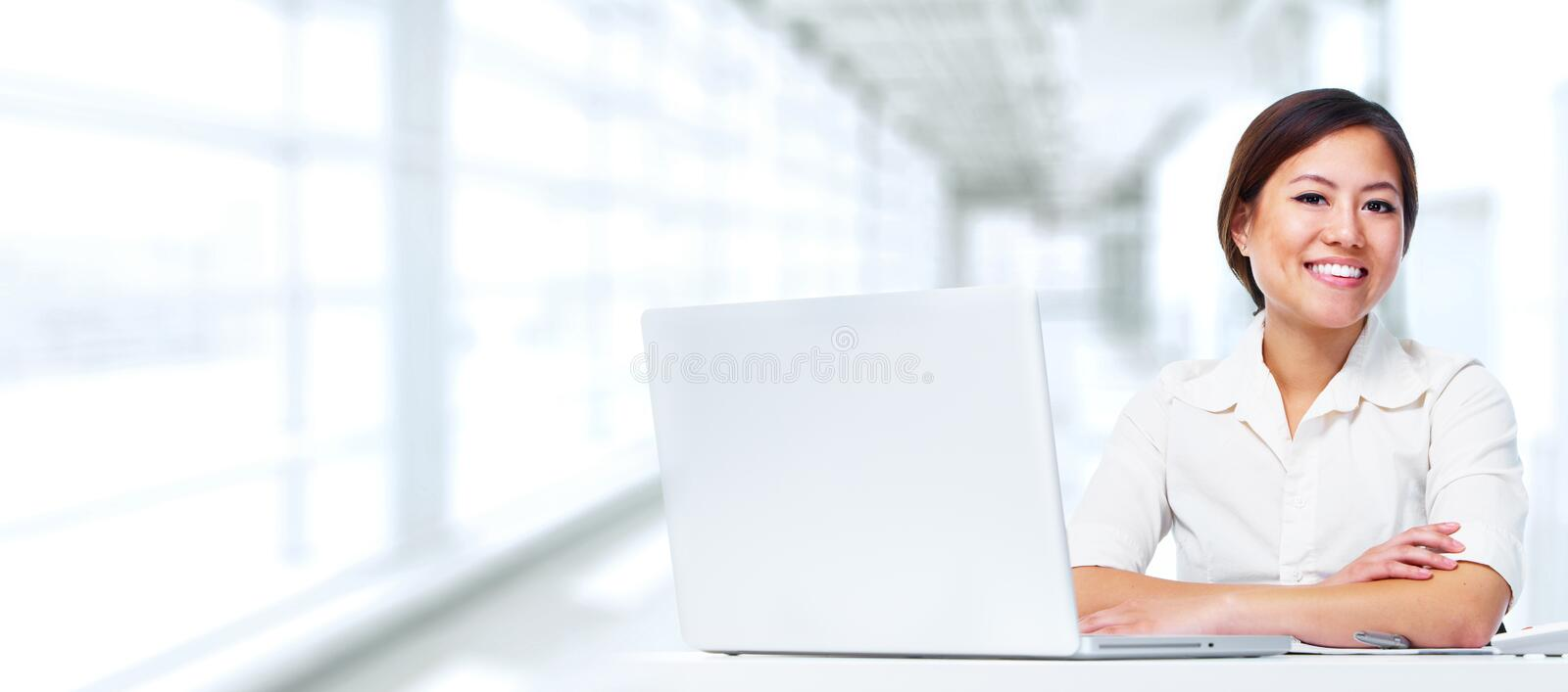Business woman with laptop. royalty free stock image