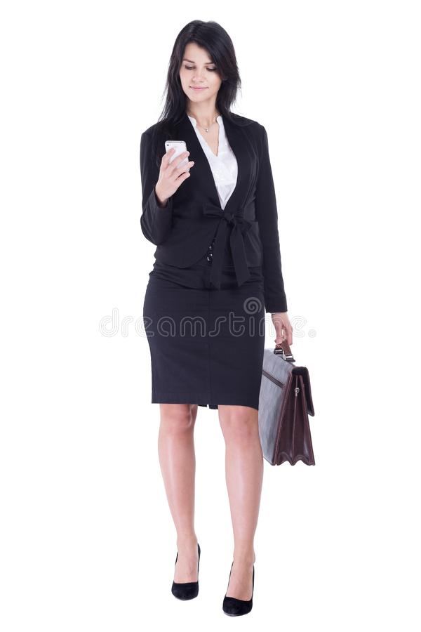 Business woman with leather briefcase reads SMS on her smartphone royalty free stock images