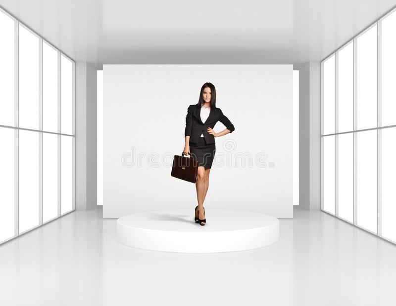 Business woman with leather briefcase standing on stock photos
