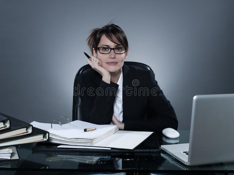 Business Woman Listening Looking At Camera Stock Photography