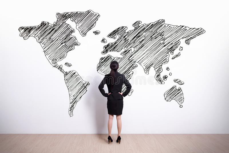 Business woman look world map royalty free stock images