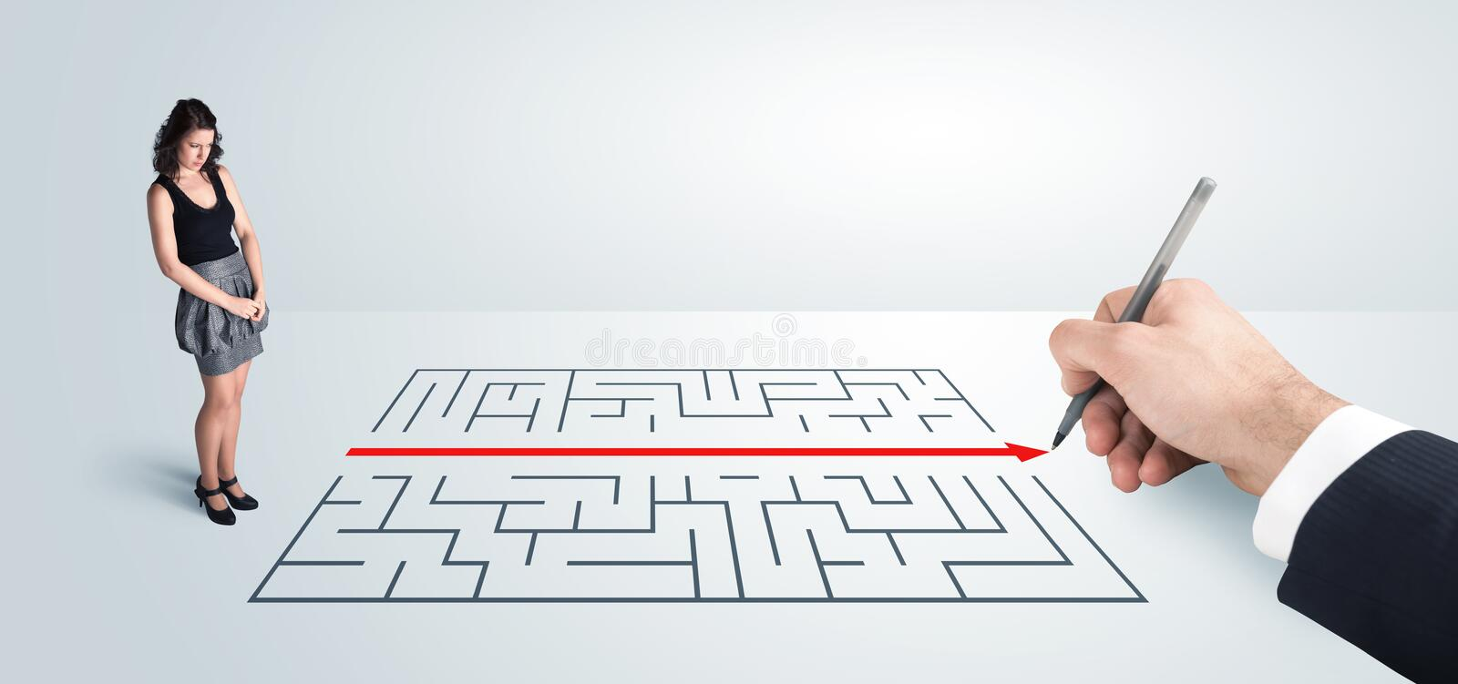 Business woman looking at hand drawing solution for maze. Solution concept stock image