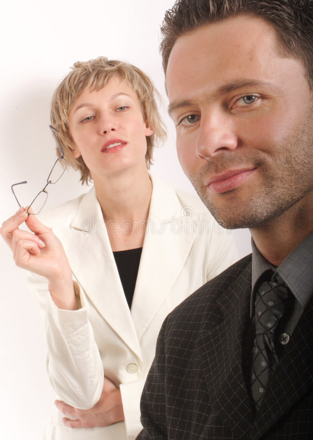 Business woman looking at handsom business man stock photos