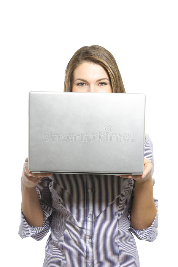 A business woman looking over her laptop. In the studio royalty free stock photos