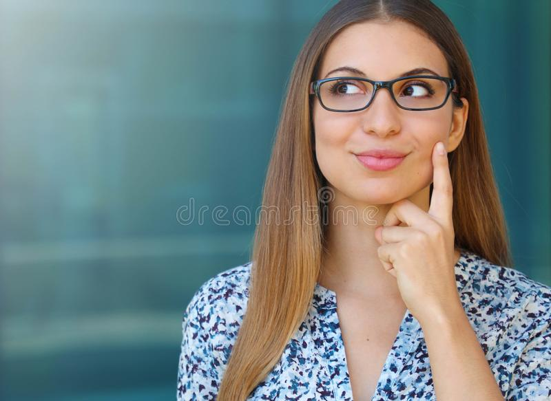 Business woman looking to the side the copy space area and looks like she had a good idea.  royalty free stock photos
