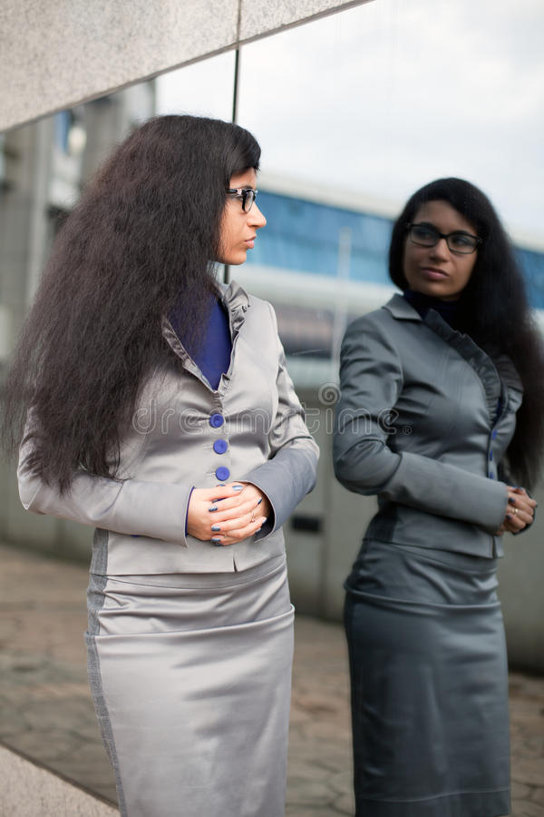 The business woman looks in a mirror royalty free stock photo