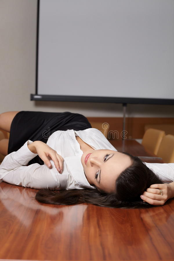 Free Business Woman Lying On The Desk Stock Photo - 23185110