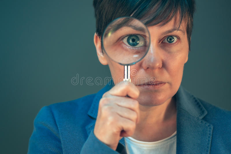 Business woman with magnifying glass stock image