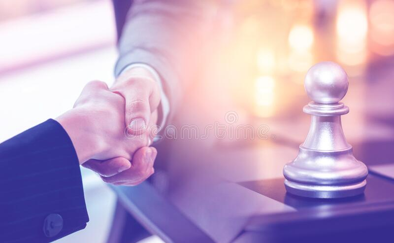 Business woman making a deal for money with Chess battle for Business financial handshake success deal concept. Business woman is making a deal for money with royalty free stock photos
