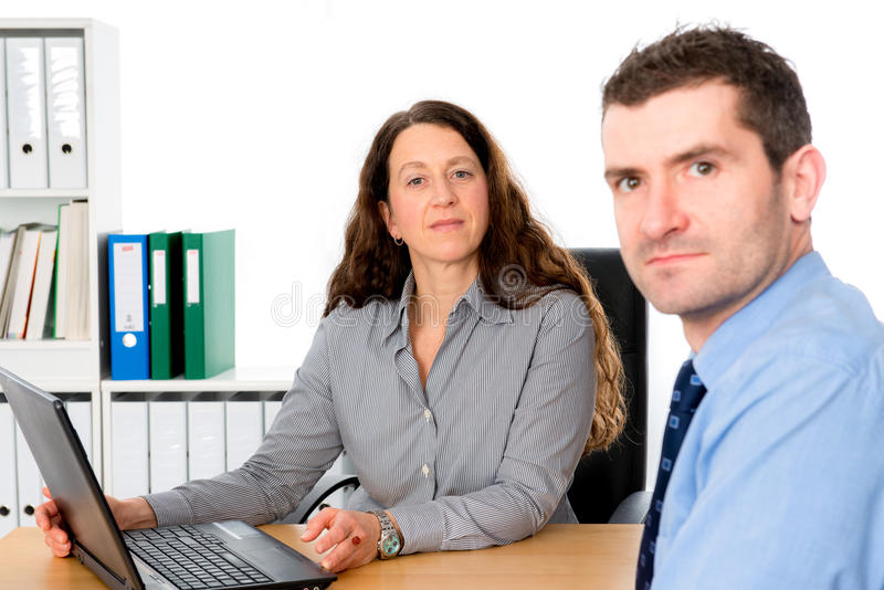 Business woman and a man in counseling. Business women and a men in counseling interview royalty free stock images