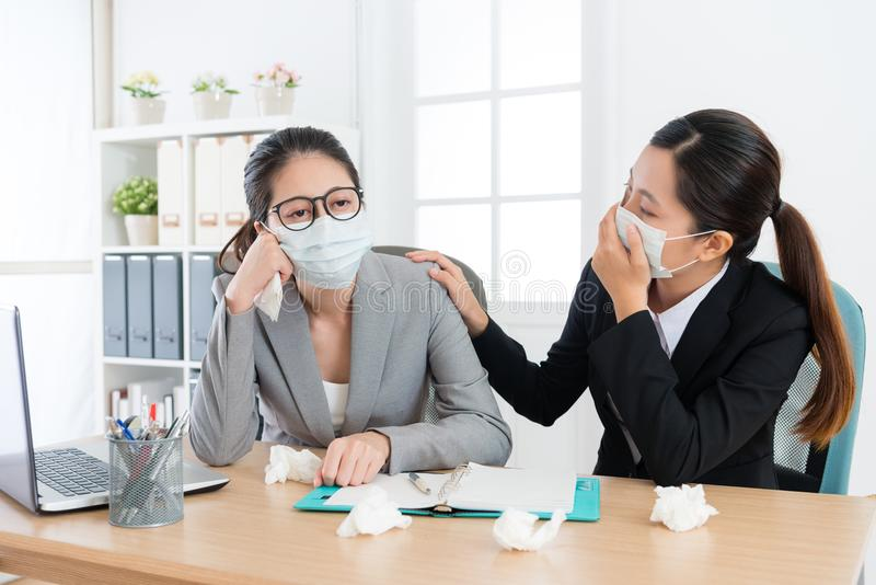 Business woman manager feeling uncomfortable. Sadness pretty business women manager feeling uncomfortable and female employee concerned her when she catches cold royalty free stock image