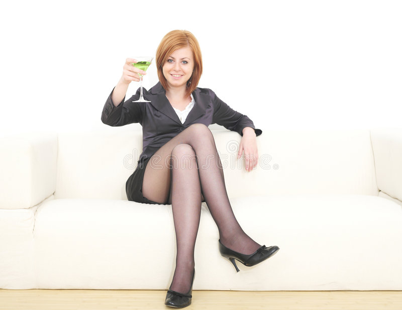 Business woman with martini. Young business woman with martini glass royalty free stock image