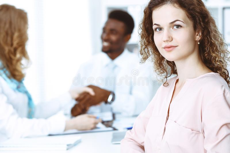Business woman at meeting in office, colored in white. Multi ethnic business people group stock images