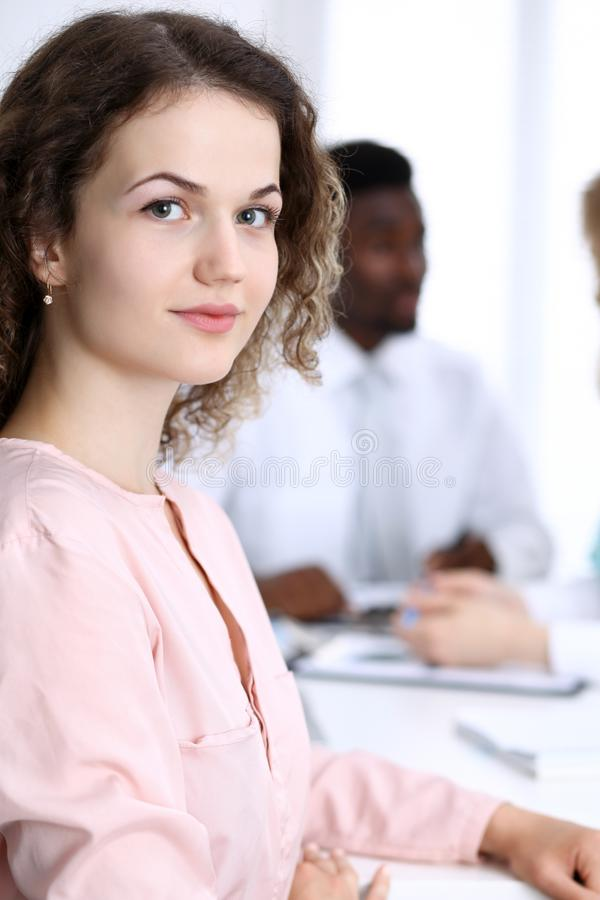 Business woman at meeting in office, colored in white. Multi ethnic business people group royalty free stock photography