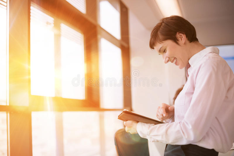Business woman on meeting using tablet computer royalty free stock images