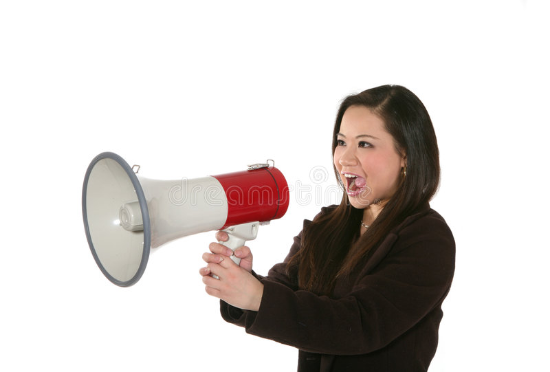 Business Woman with Megaphone. A business woman shouting into a megaphone royalty free stock photo