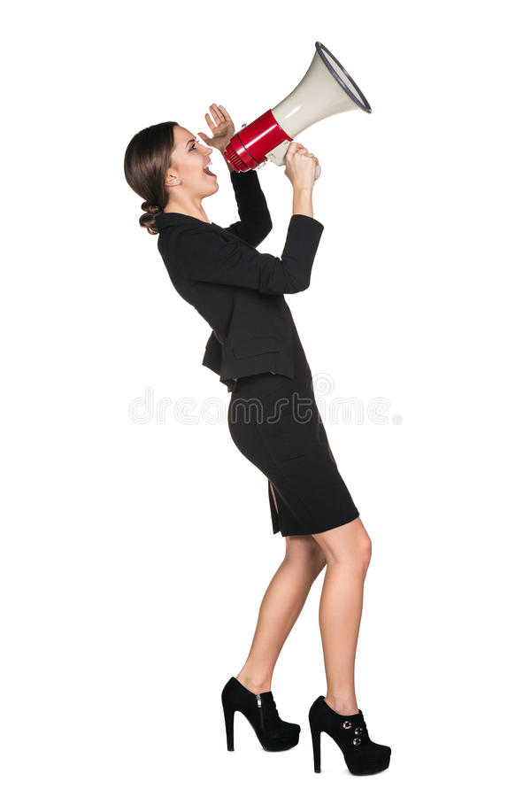 Business woman with megaphone. Yelling and screaming isolated on white background stock photo