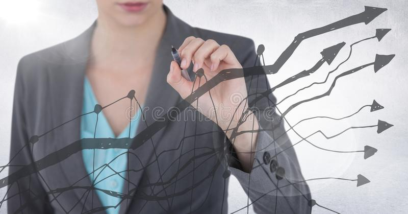 Business woman mid section with pen behind grey graph against white background and flare stock photo