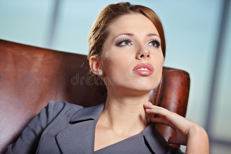 Business woman in modern interior stock photography