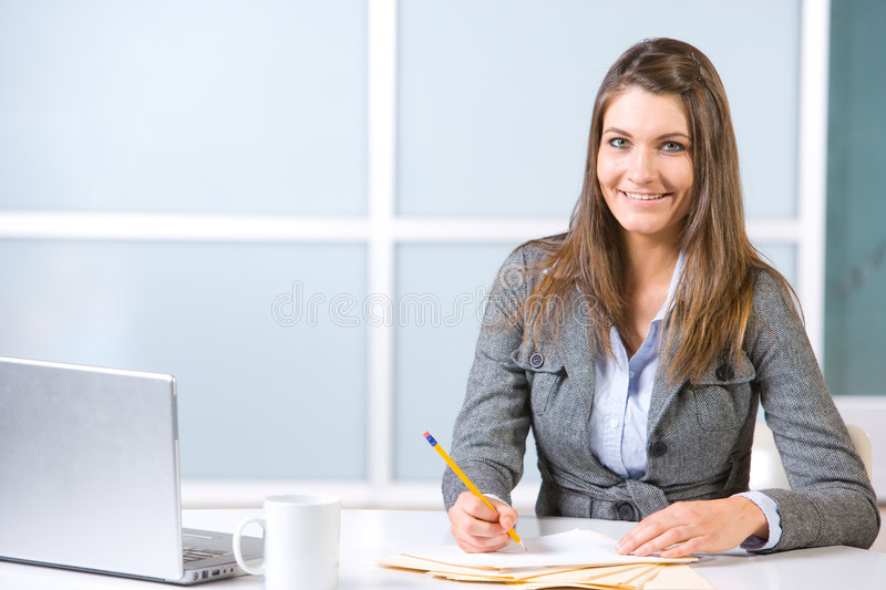 Business woman in modern office royalty free stock photos