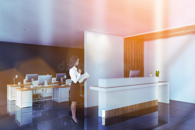Business woman near white office reception stock photography