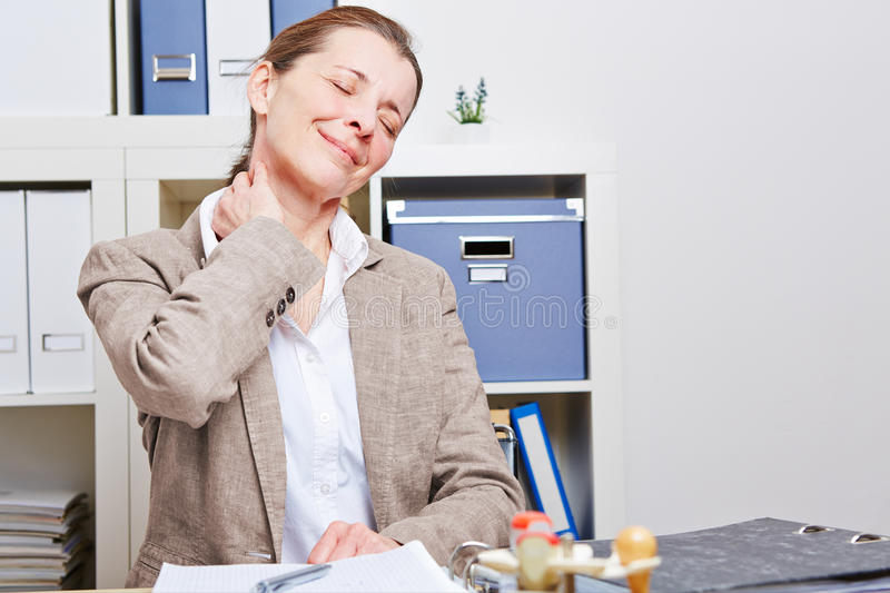 Business woman with neck pain stock photo