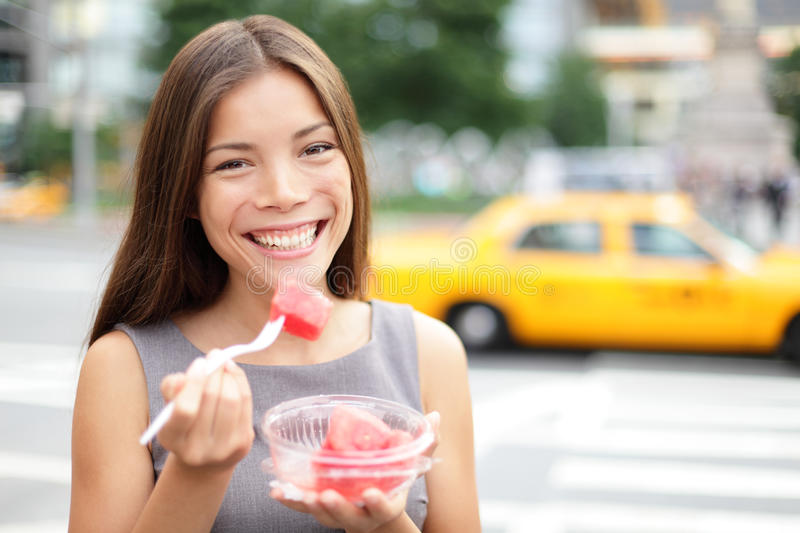 Business woman in New York eating watermelon snack stock photo