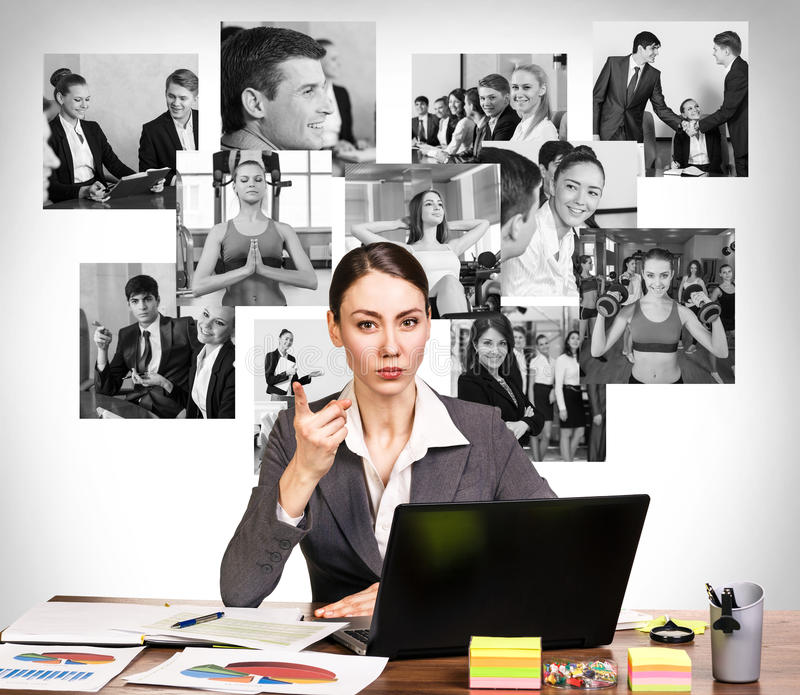 Business woman with notebook and collage. Young pretty business women wags one's finger in the office and collage on the wall stock images
