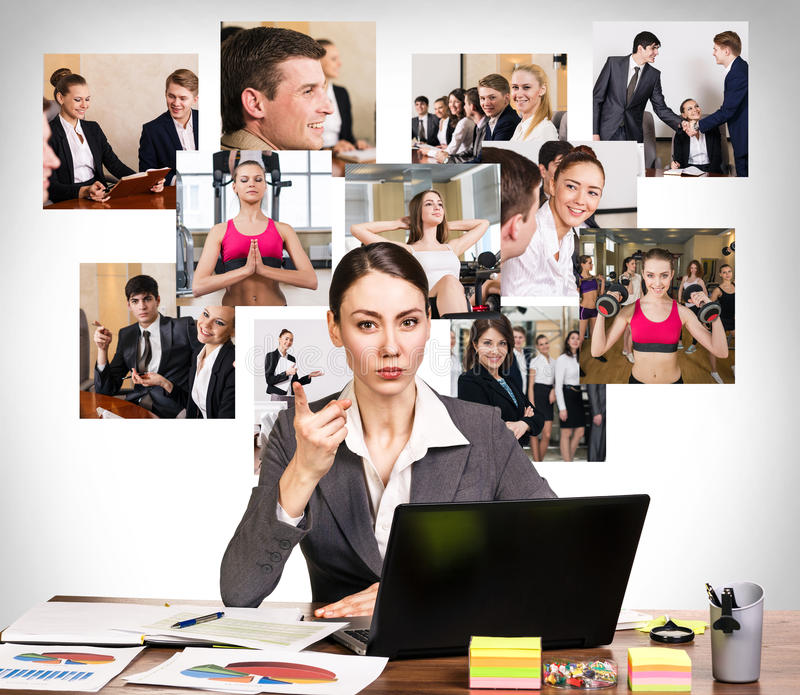 Business woman with notebook and collage. Young pretty business women wags one's finger in the office and collage on the wall stock photo