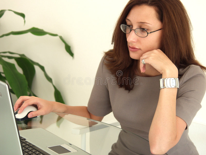 Business Woman at Notebook PC royalty free stock images