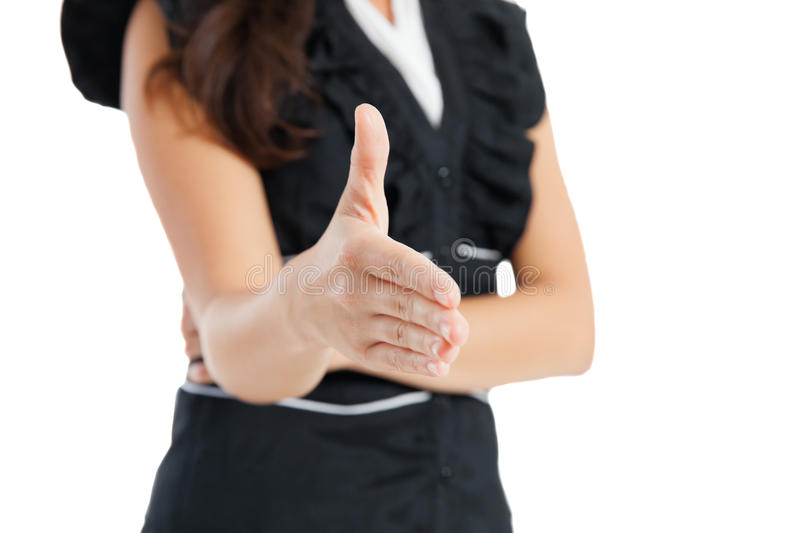 Business woman offering for handshake. Happy young businesswoman ready to seal a deal, against white background royalty free stock photos