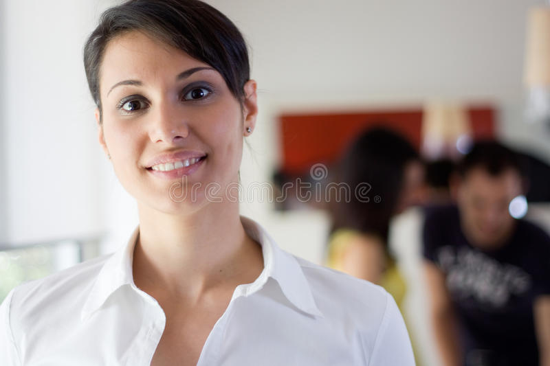 Business woman in the office. With possitive attitude stock image