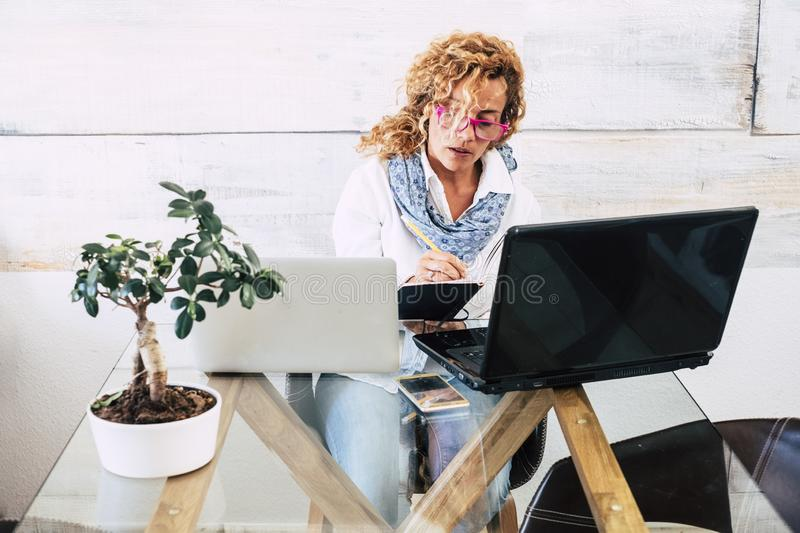 Business woman at office with double laptop workstation - concept of stress and work for people - home free job  and beautiful royalty free stock photography