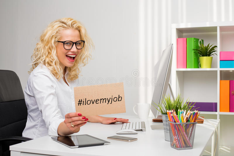 Business Woman In Office Showing I Love My Job Cardboard Stock