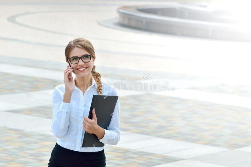 Business woman office worker talking on smartphone smiling happy royalty free stock image