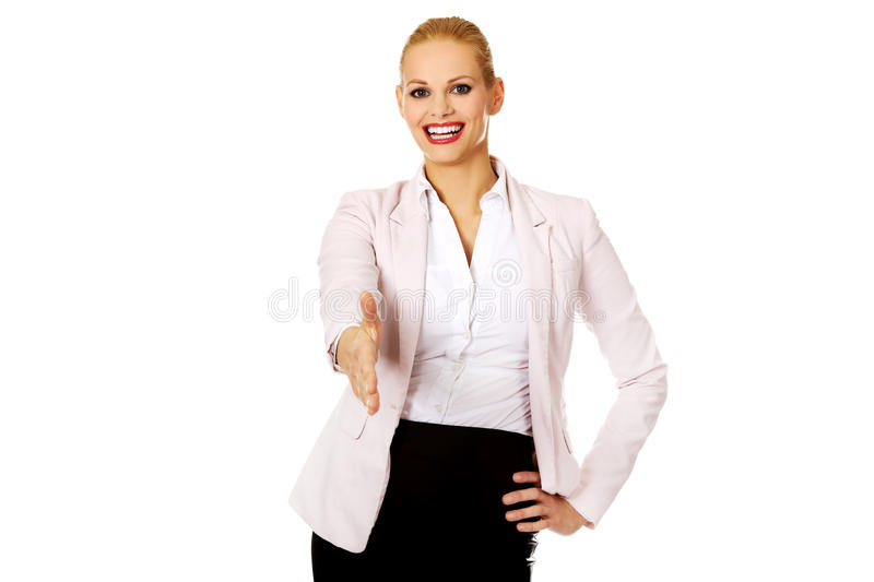 Business woman with an open hand ready for handshake stock image