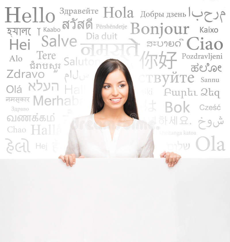 Business woman over the background with a different world languages (foreign language school) royalty free stock photo